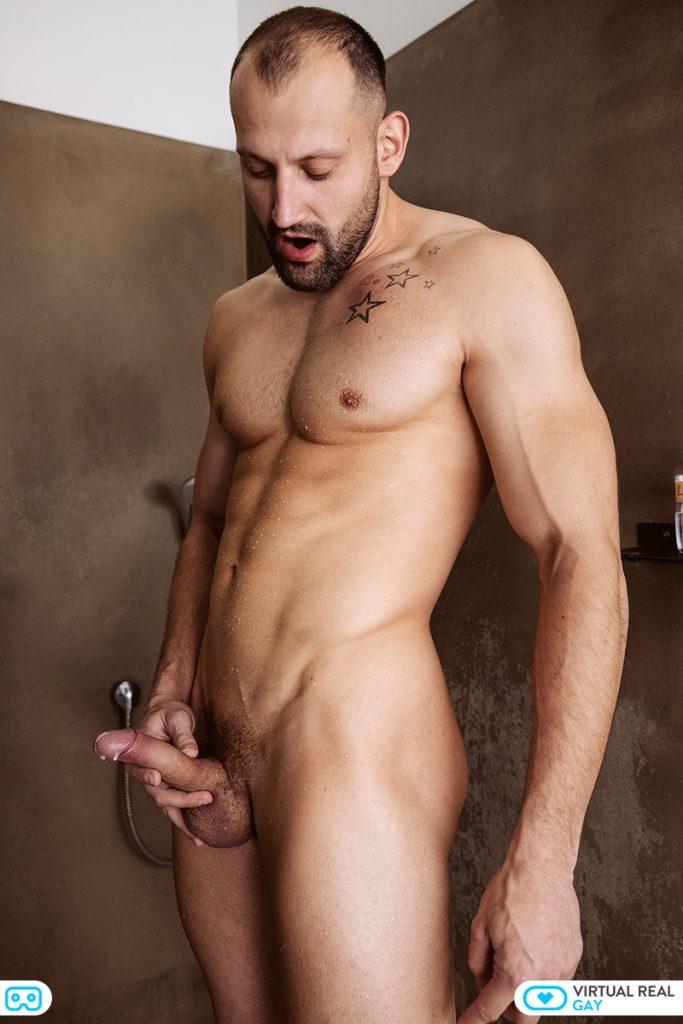 naked Czech gym hunk holding penis